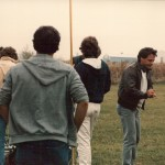 Director David Anspaugh (second from right) contemplates the shot.