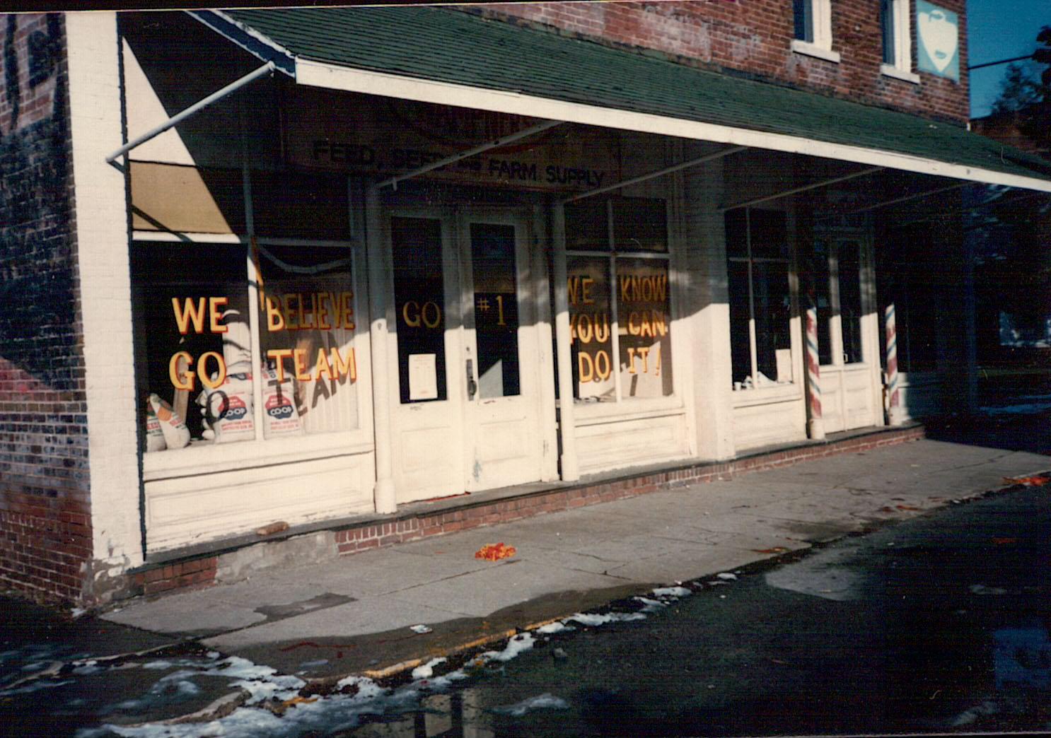Crew members painted store windows in preparation for the caravan scene, filmed December 3, 1985. It had snowed overnight.