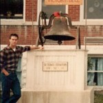 Brad Long (Buddy) poses with the victory bell.