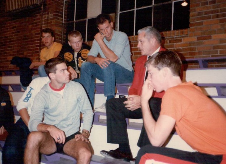The Huskers listen to Milan 1954 team member Ray Craft.
