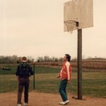 Wade Schenck (Ollie) and director David Anspaugh at the outdoor court.