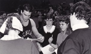 Brad Long (Buddy) signs autographs during a break in home-game filming.