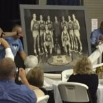 At the banquet, David Neidorf presents the original Huskers team photo from the movie's final scene. His father owned it for 30 years before giving it to the Hoosier Gym.